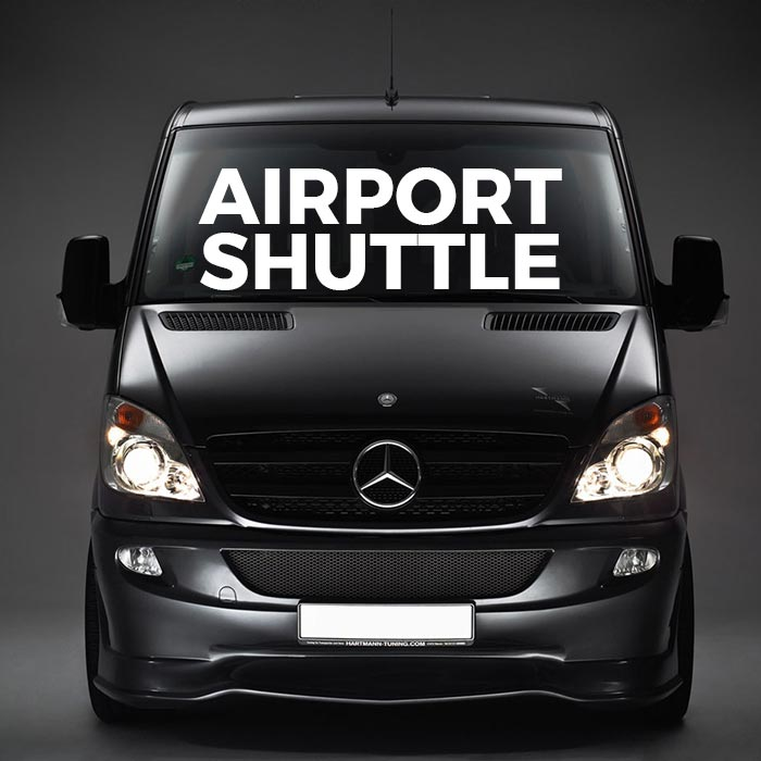 Photo of a van with the words Airport Shuttle superimposed on it.